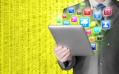 Business man use tablet pc with colorful application icons — Stock Photo