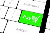 Zapłacić klucz z zakupy koszyka ikona na białym klawiatury — Zdjęcie stockowe