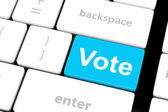 Vote button on computer keyboard showing internet concept — Stock Photo