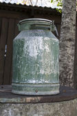 Old metal milk can — Stock Photo