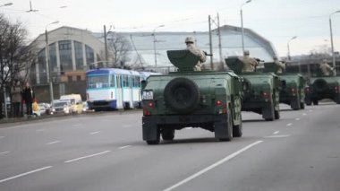 Armed Forces trucks in city streets — Stock Video