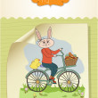 Easter bunny with a basket of Easter eggs — Stock Photo #22301447