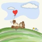 Cute doodle teddy bear with heart on meadow — Stock Vector