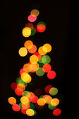 Christmas lights as xmas tree — Stock Photo