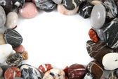 Color stones background as frame — Stock Photo