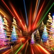 Christmas forest from the color lights — Stock Photo #13517088