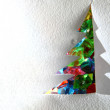 Christmas tree from the paper and snow — Stock Photo