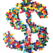 Dollar sign from plastic caps — Stock Photo #19823271
