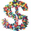 Dollar sign from plastic caps - Stock Photo
