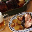 Royalty-Free Stock Photo: Roasted pork knuckle with potatoes and beer