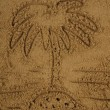 Palm drawing in the sand - Stock Photo