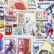 Stock Photo: Used postage stamps collection background