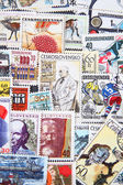 Used postage stamps collection background — Stock Photo