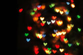 Abstract christmas background (color heart lights) — Stock Photo