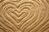 Yellow sand texture (heart) — Stock Photo
