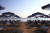 Greece beach with parasols  — Stock Photo