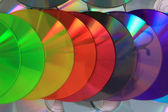 Color CD and DVD background — Stock Photo