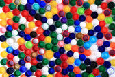 Color plastic caps background — Stock Photo