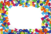 Color plastic letters frame — Stock Photo