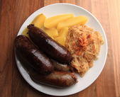 Czech food - black and white pudding with potatoes and sauerkrau — Stockfoto