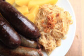 Czech food - black and white pudding with potatoes and sauerkrau — Stock Photo