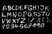 Snow christmas alphabet on black background — Stock Photo