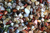 Natural color gems background — Stock Photo