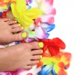 Women feets and flowers (pedicure tbackground) — Stock Photo #46703811