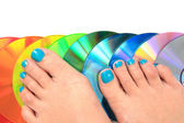 Woman feets and colors  — Stock Photo