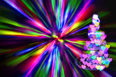 Christmas tree with many colors in the dark nigt — Stock Photo