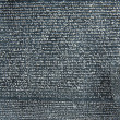 Old letters in the stone as history background — Stock Photo #7650765
