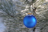 Blue Christmas Ornament in Snowy Pine Tree — Stock Photo