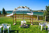 Beach wedding arch with flowers — Stock Photo
