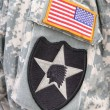 Indian head and flag patch on army soldier uniform - Stock Photo