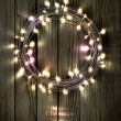 Glowing Christmas wreath made of led lights — Stock Vector