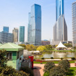 City park with modern building background in shanghai — Stok fotoğraf