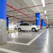 Parking garage, underground interior with a few parked cars - Foto Stock