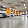 Parking garage, underground interior with a few parked cars — Stock Photo #18870951