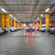 Parking garage, underground interior with a few parked cars — Stock Photo #18870963