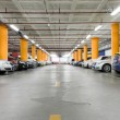 Parking garage, underground interior with a few parked cars — Stock Photo #18871011
