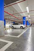 Parking garage, underground interior with a few parked cars — Stock Photo