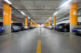 Parking garage, underground interior with a few parked cars — Foto Stock