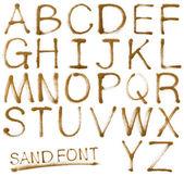 Abc que contiene letras, aisladas sobre fondo blanco de la arena — Foto de Stock