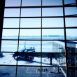 Parked aircraft on an airport through the gate window - Lizenzfreies Foto