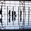 Travelers silhouettes at airport - Lizenzfreies Foto