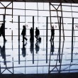 Travelers silhouettes at airport - Foto de Stock  