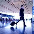 Hurrying in airport - Stock Photo