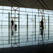 Stock Photo: Travelers silhouettes at airport