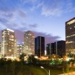 Office buildings in downtown Beijing at night — Stock Photo