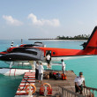 Red seaplane at the docks of an exotic resort in Maldives — Stock Photo
